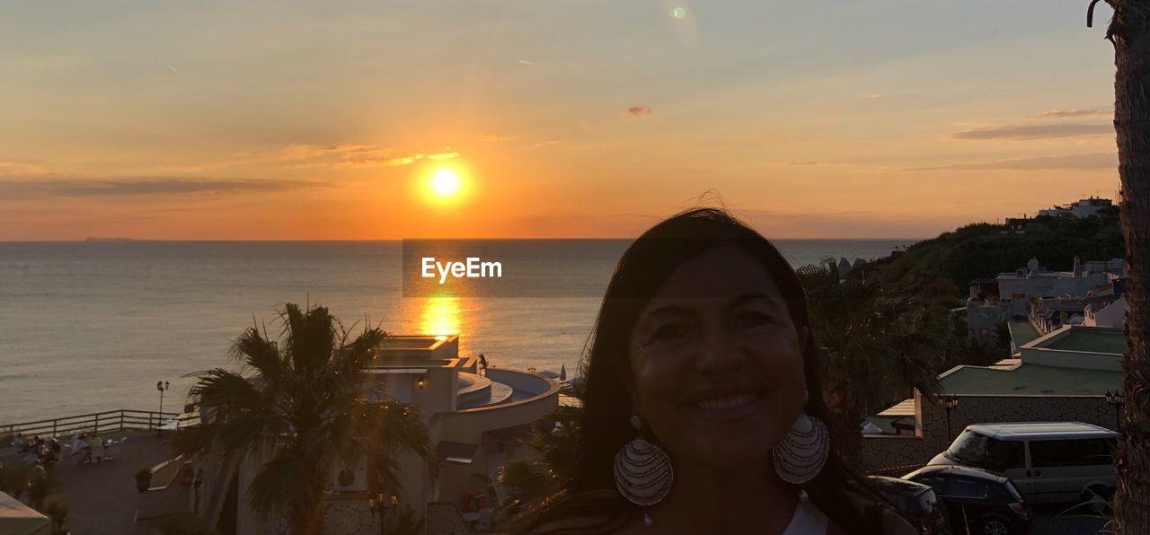 sunset, sky, water, sea, orange color, sun, beauty in nature, nature, scenics - nature, cloud - sky, horizon over water, horizon, sculpture, portrait, idyllic, human representation, headshot, outdoors, tree