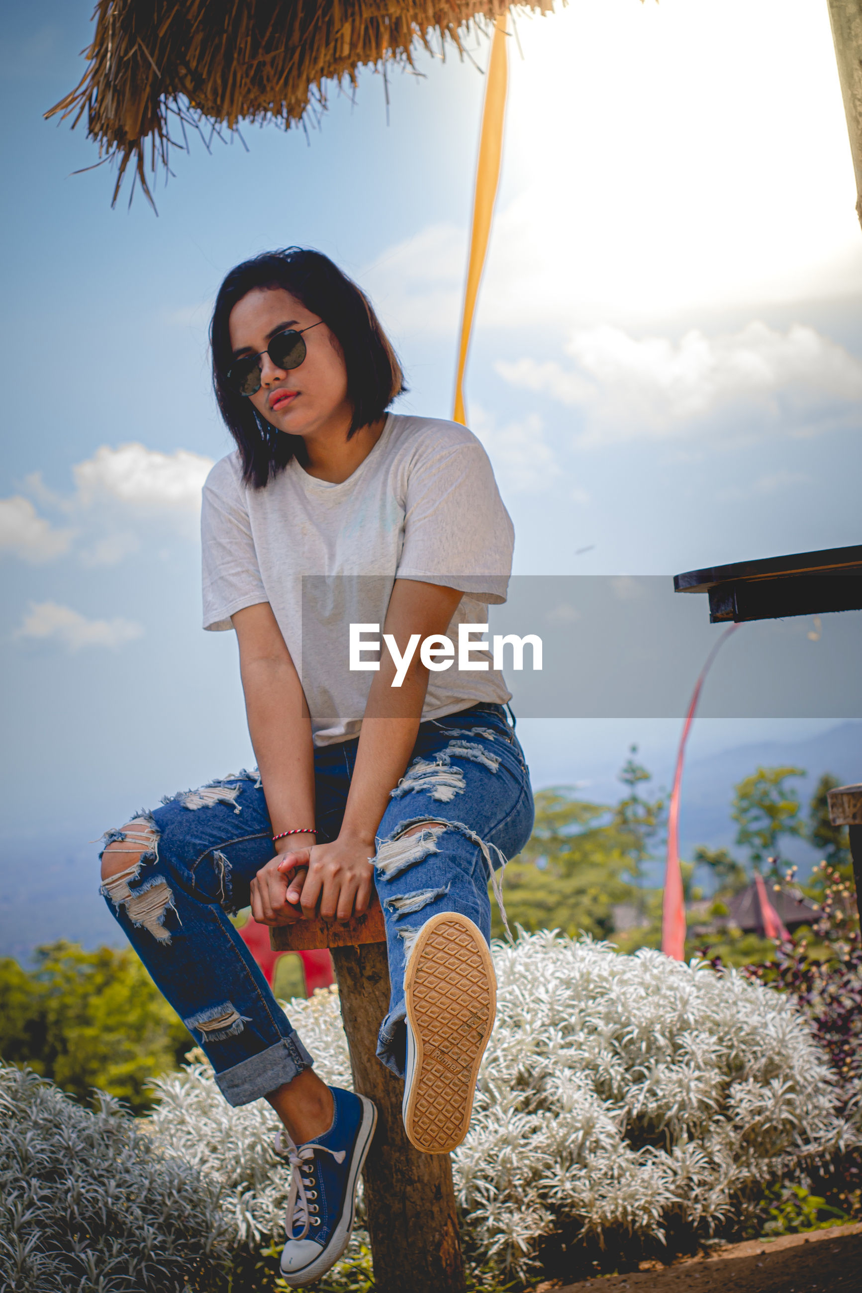 young woman Woman Woman Portrait Women Of EyeEm Spraying Full Length Standing Protective Glove Holding Front View Sky Cloud - Sky Casual Clothing Garden Hose Gardening Glove Gardening Equipment Watering Rake Gardening Florist Petunia Community Garden Sprinkler
