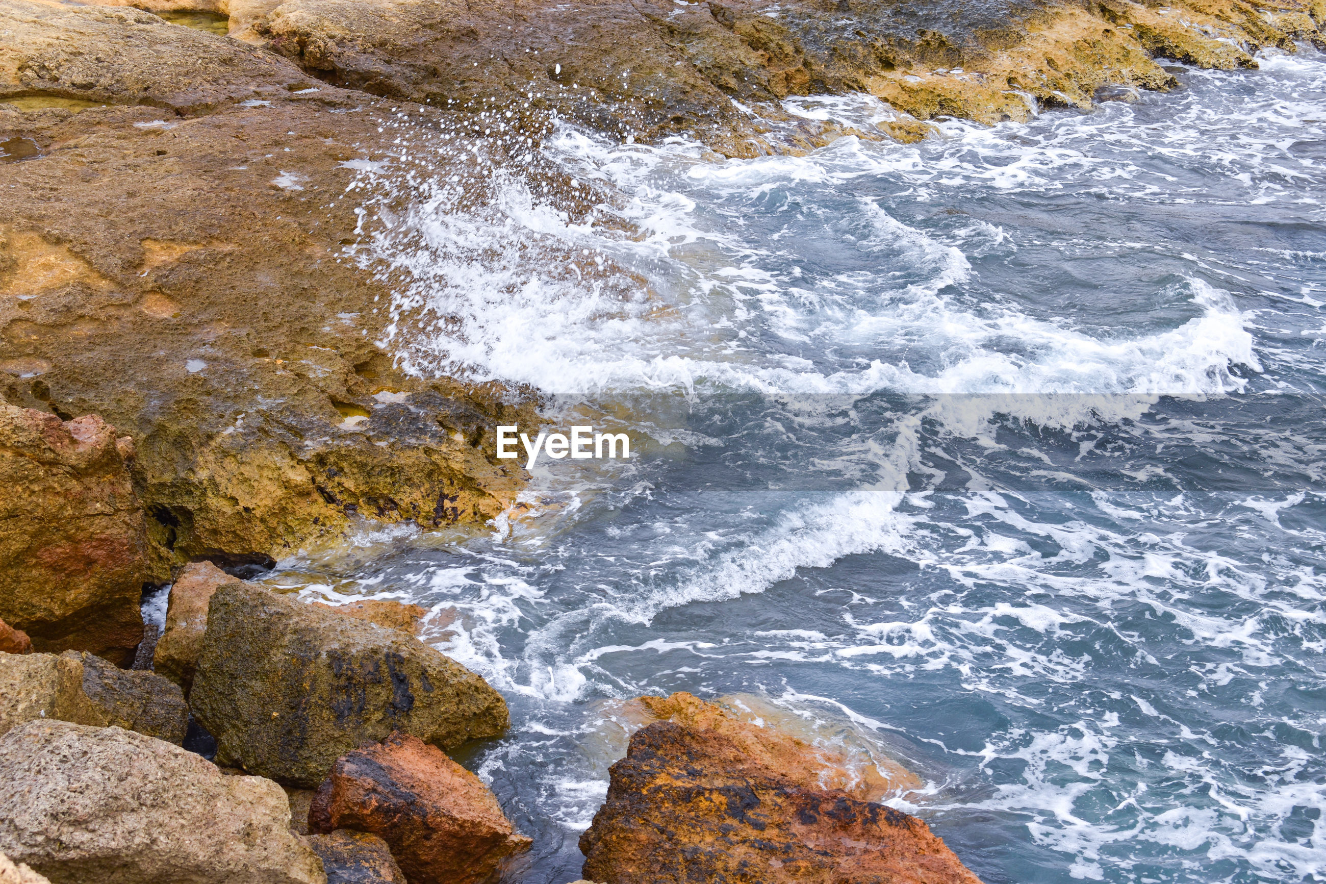 sea, water, rock - object, nature, wave, motion, no people, beauty in nature, high angle view, day, outdoors, scenics