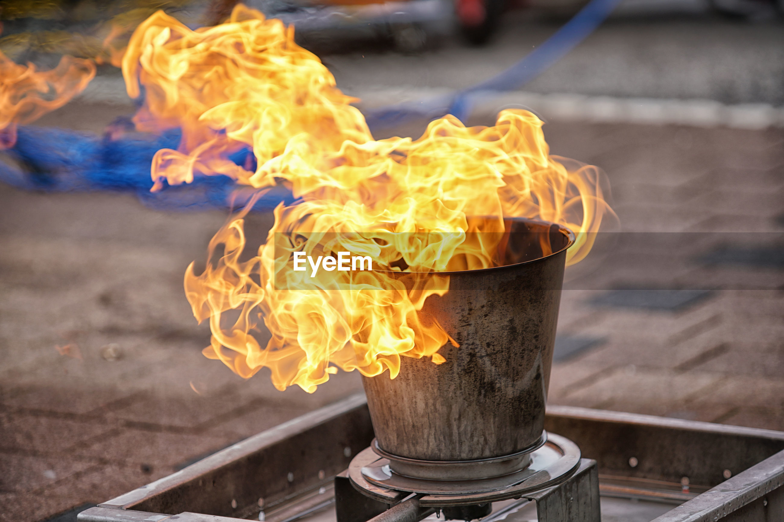 CLOSE-UP OF FIRE BURNING ON METAL