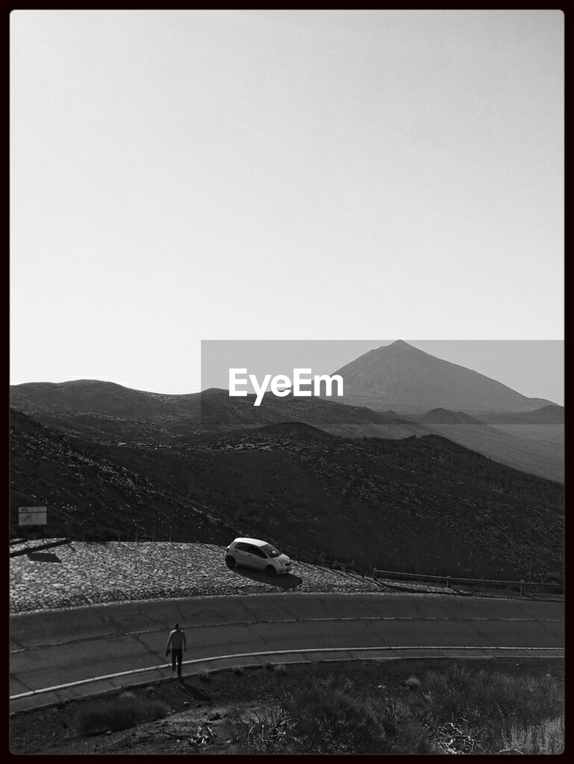 mountain, transfer print, clear sky, copy space, mountain range, landscape, auto post production filter, tranquil scene, tranquility, scenics, transportation, beauty in nature, nature, road, non-urban scene, outdoors, remote, land vehicle, field, horizon over land