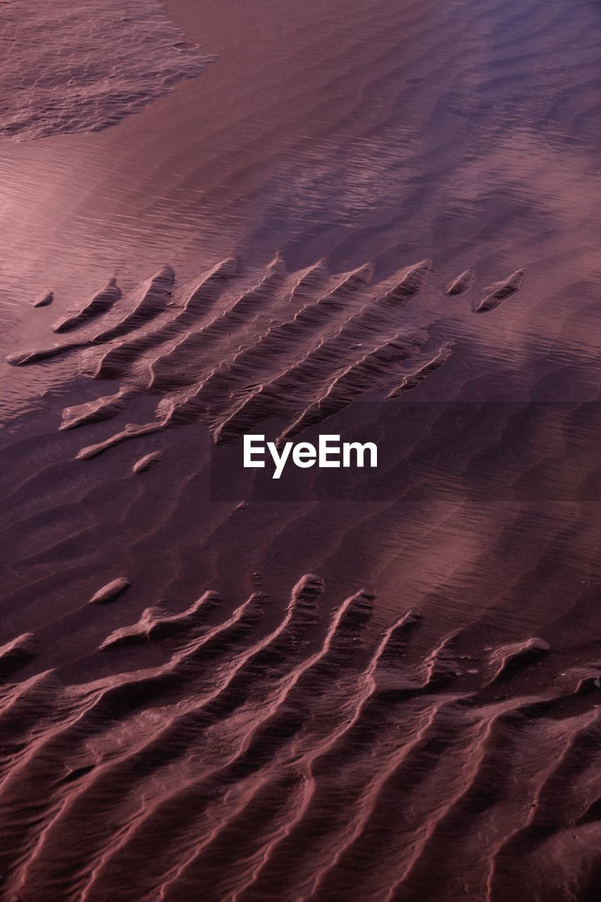 backgrounds, pattern, no people, sand, land, full frame, natural pattern, climate, high angle view, desert, sand dune, scenics - nature, beauty in nature, nature, arid climate, tranquility, wave pattern, day, rippled, landscape