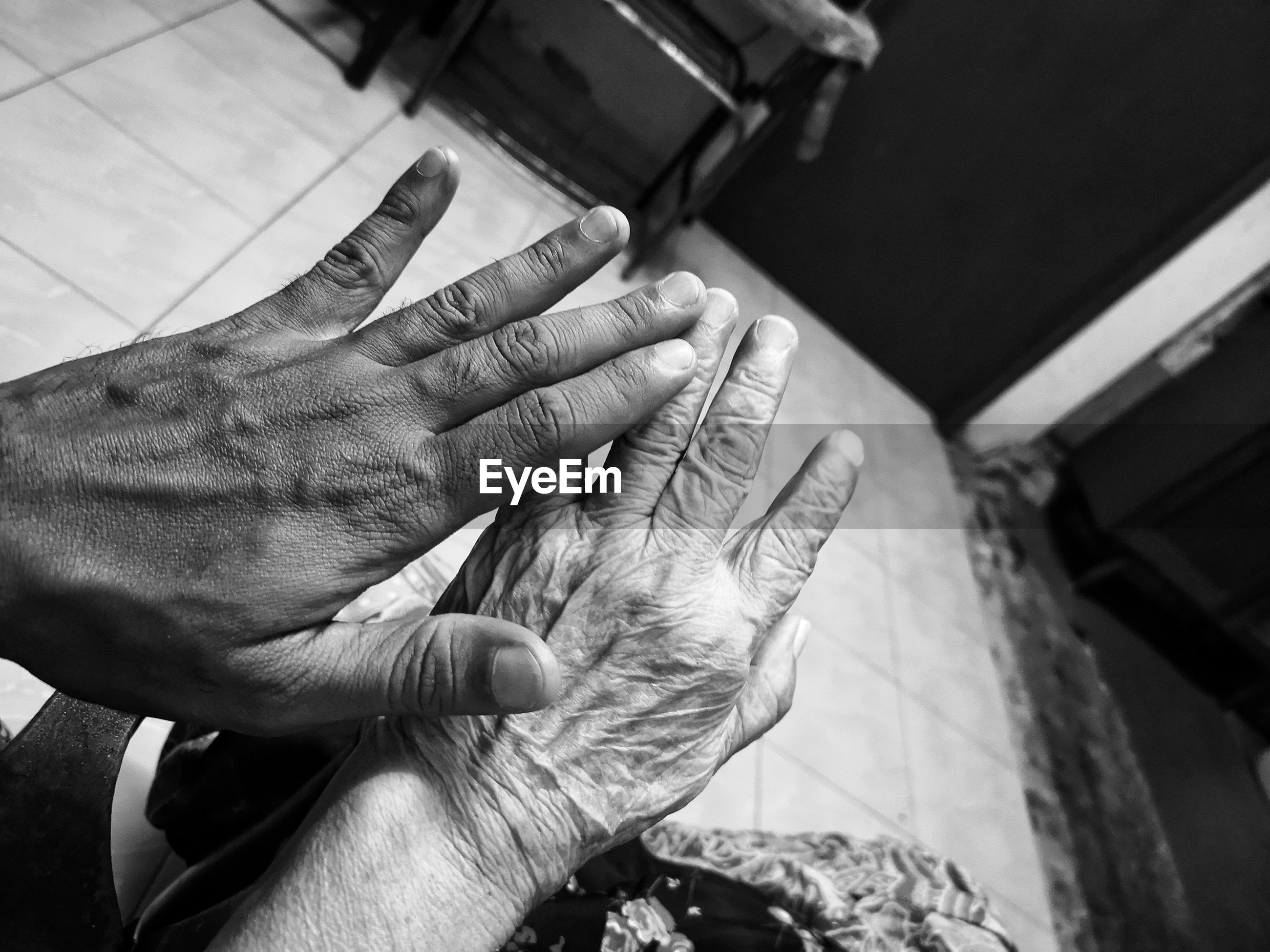 Cropped hands of women at home