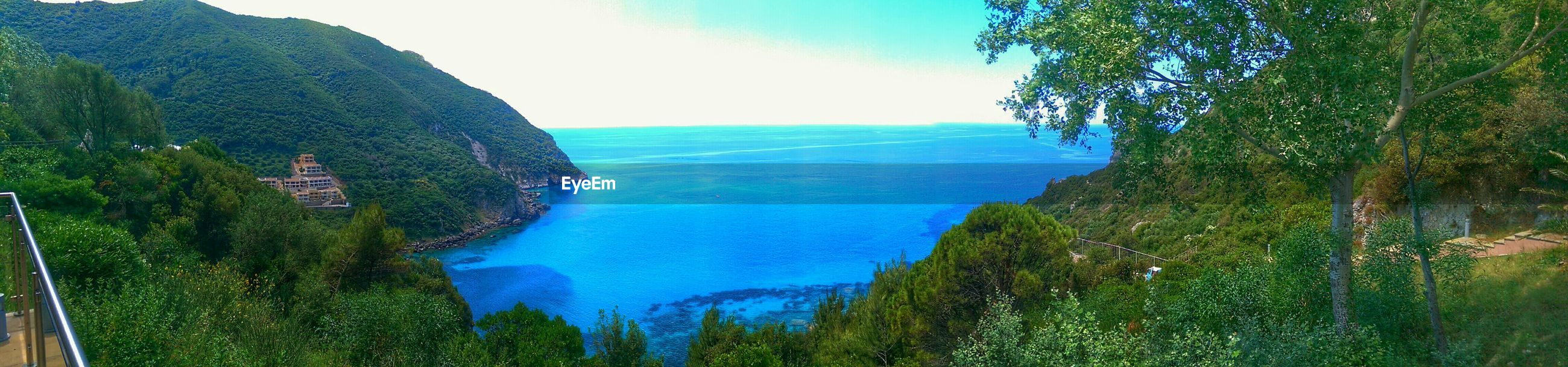 tranquil scene, scenics, tranquility, sea, beauty in nature, horizon over water, sky, tree, nature, blue, mountain, water, green color, landscape, idyllic, panoramic, non-urban scene, remote, high angle view, growth