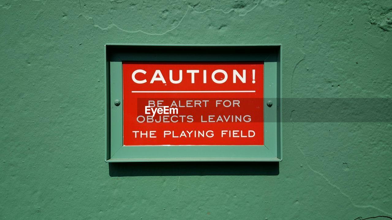 Warning sign on wall