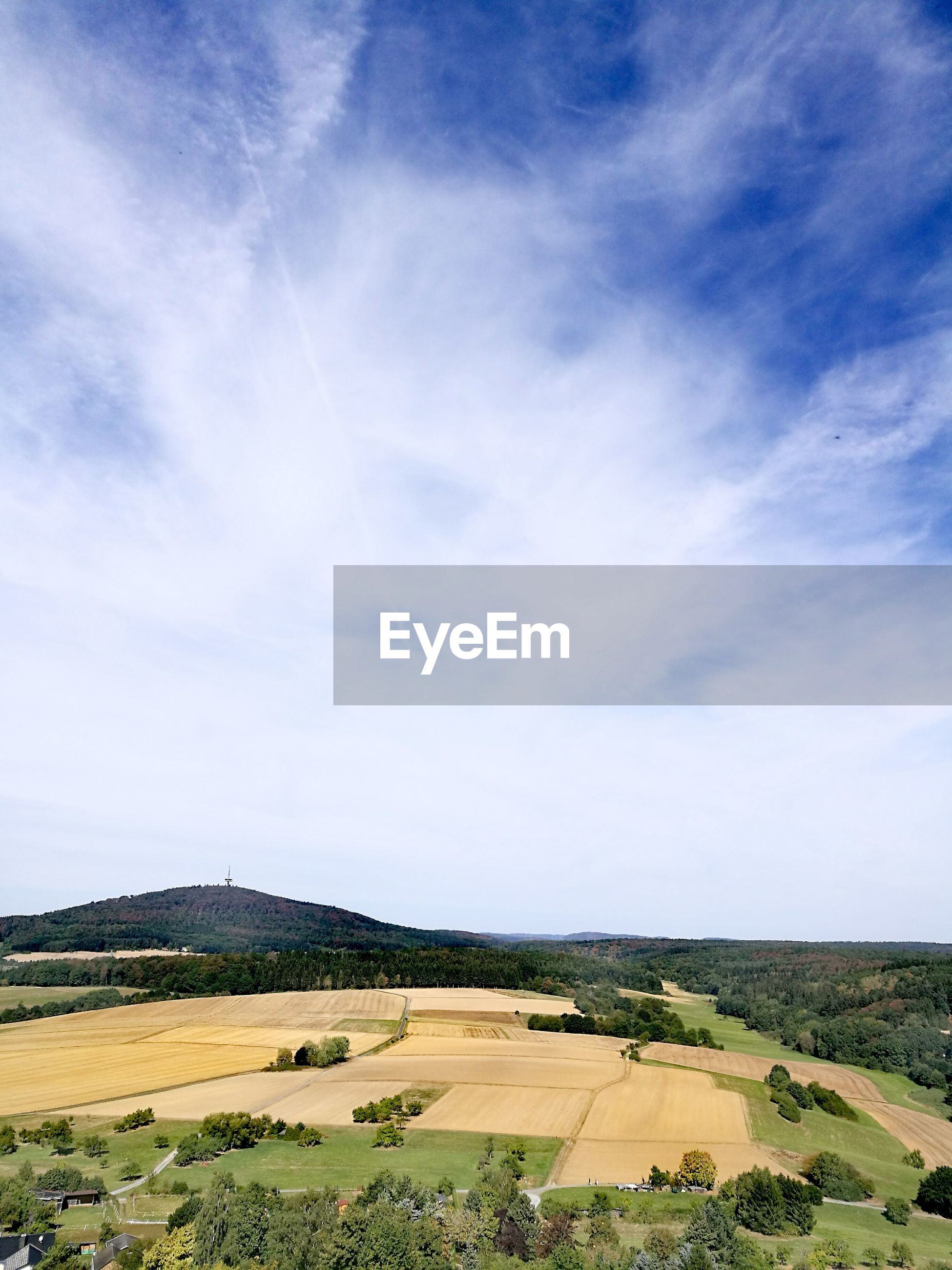 VIEW OF RURAL LANDSCAPE AGAINST CLOUDY SKY