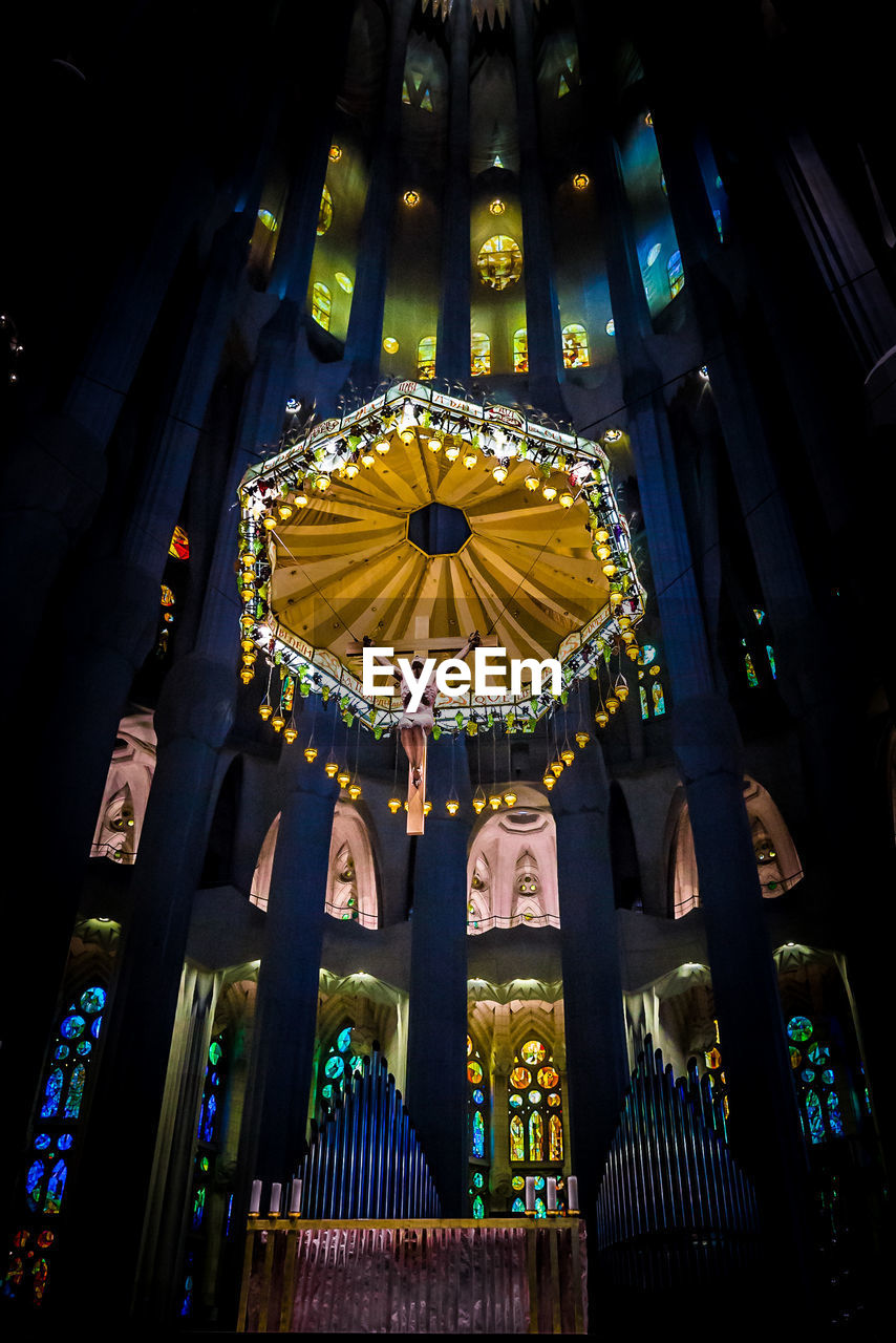 low angle view, place of worship, religion, spirituality, architecture, illuminated, built structure, no people, statue, multi colored, indoors, day