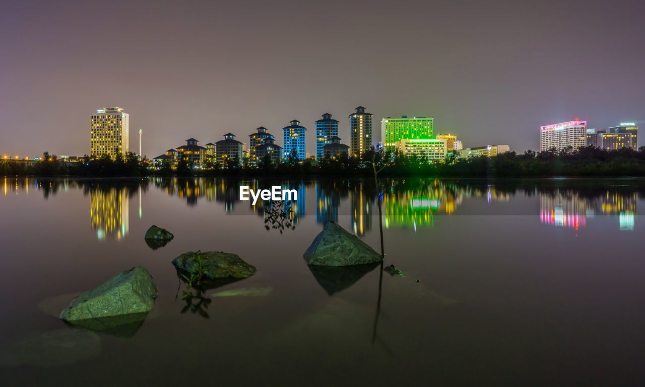 architecture, built structure, building exterior, reflection, water, building, sky, waterfront, city, nature, office building exterior, urban skyline, no people, lake, skyscraper, illuminated, landscape, night, modern, cityscape, outdoors, financial district