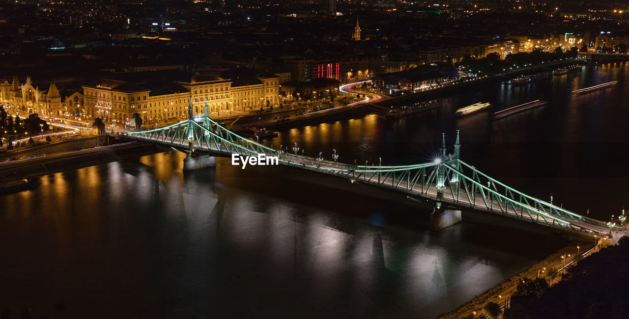 High angle view of liberty bridge over danube river in city at night