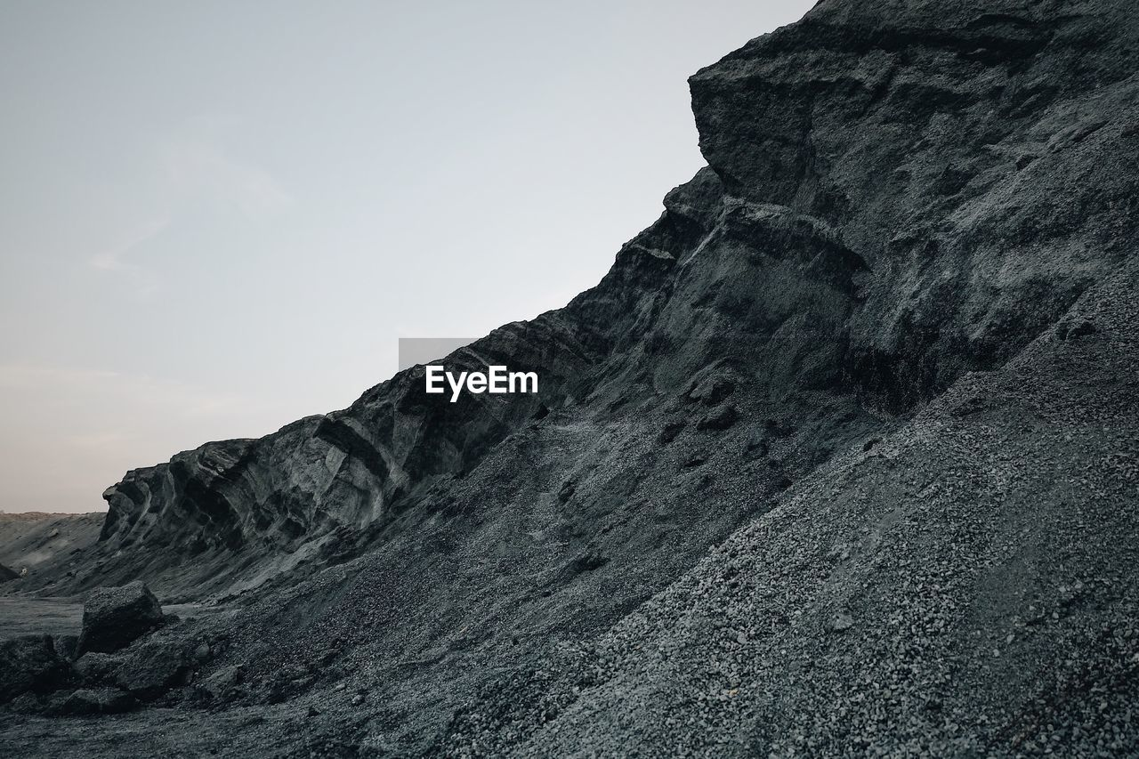 mountain, sky, rock, solid, rock - object, nature, beauty in nature, tranquil scene, low angle view, mountain range, rock formation, tranquility, no people, scenics - nature, day, physical geography, formation, geology, rocky mountains, non-urban scene, outdoors, eroded, mountain peak, arid climate