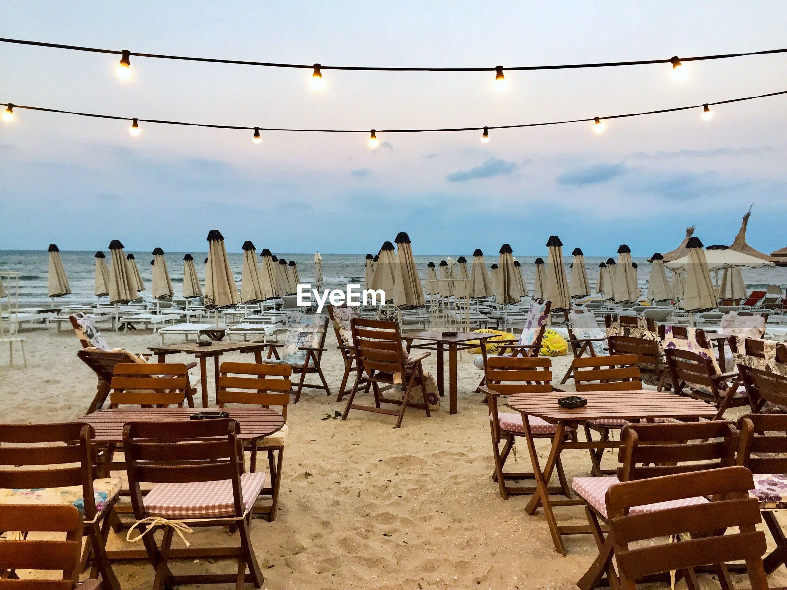 Empty restaurant on the beach at dusk