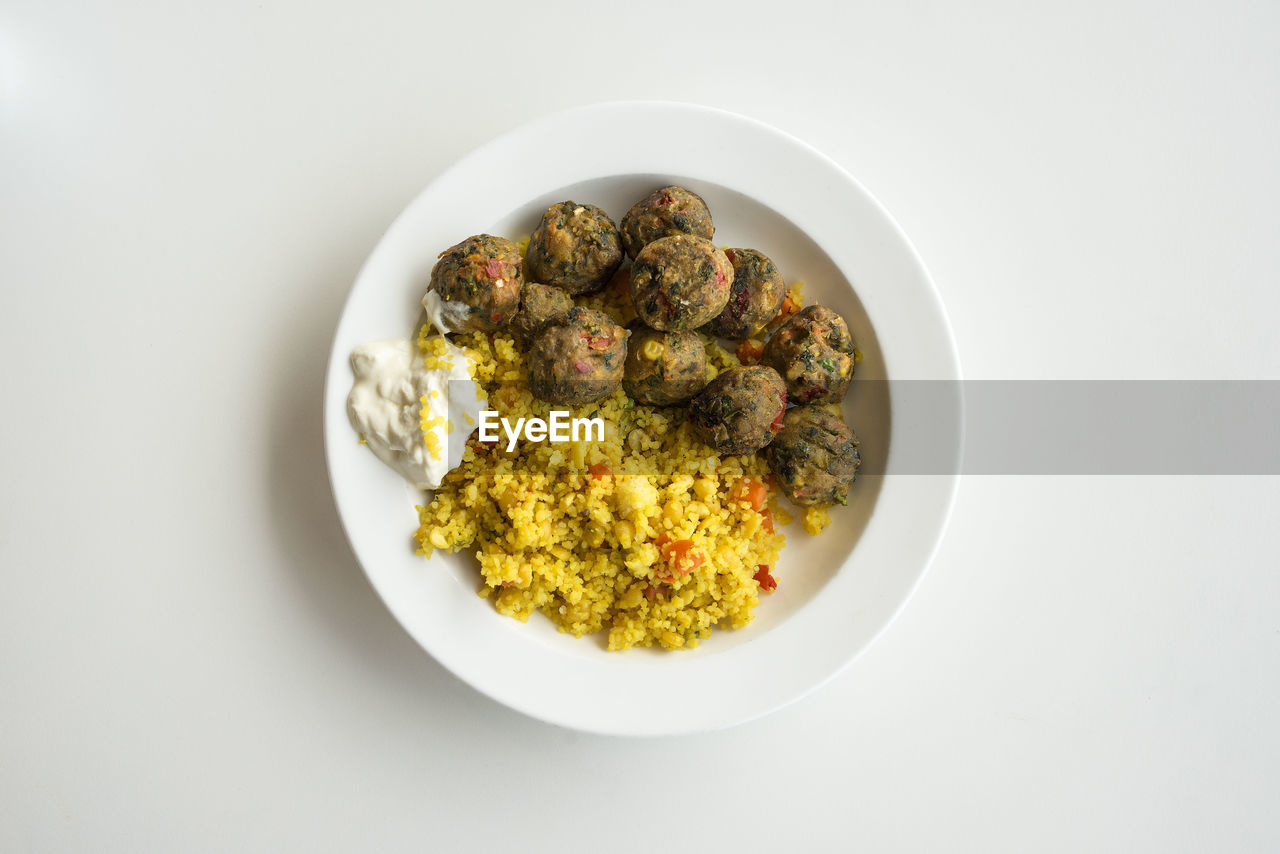 Directly Above Shot Of Food In Plate On White Background
