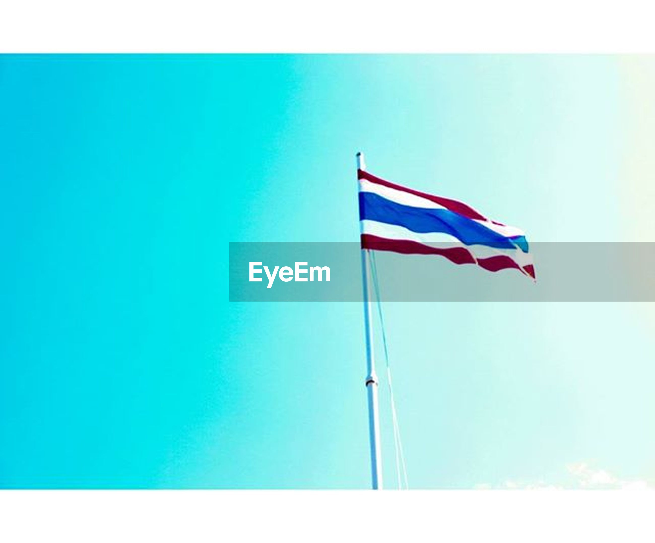 flag, patriotism, identity, national flag, low angle view, blue, american flag, wind, clear sky, culture, pole, sky, pride, striped, flag pole, red, transfer print, copy space, waving, day