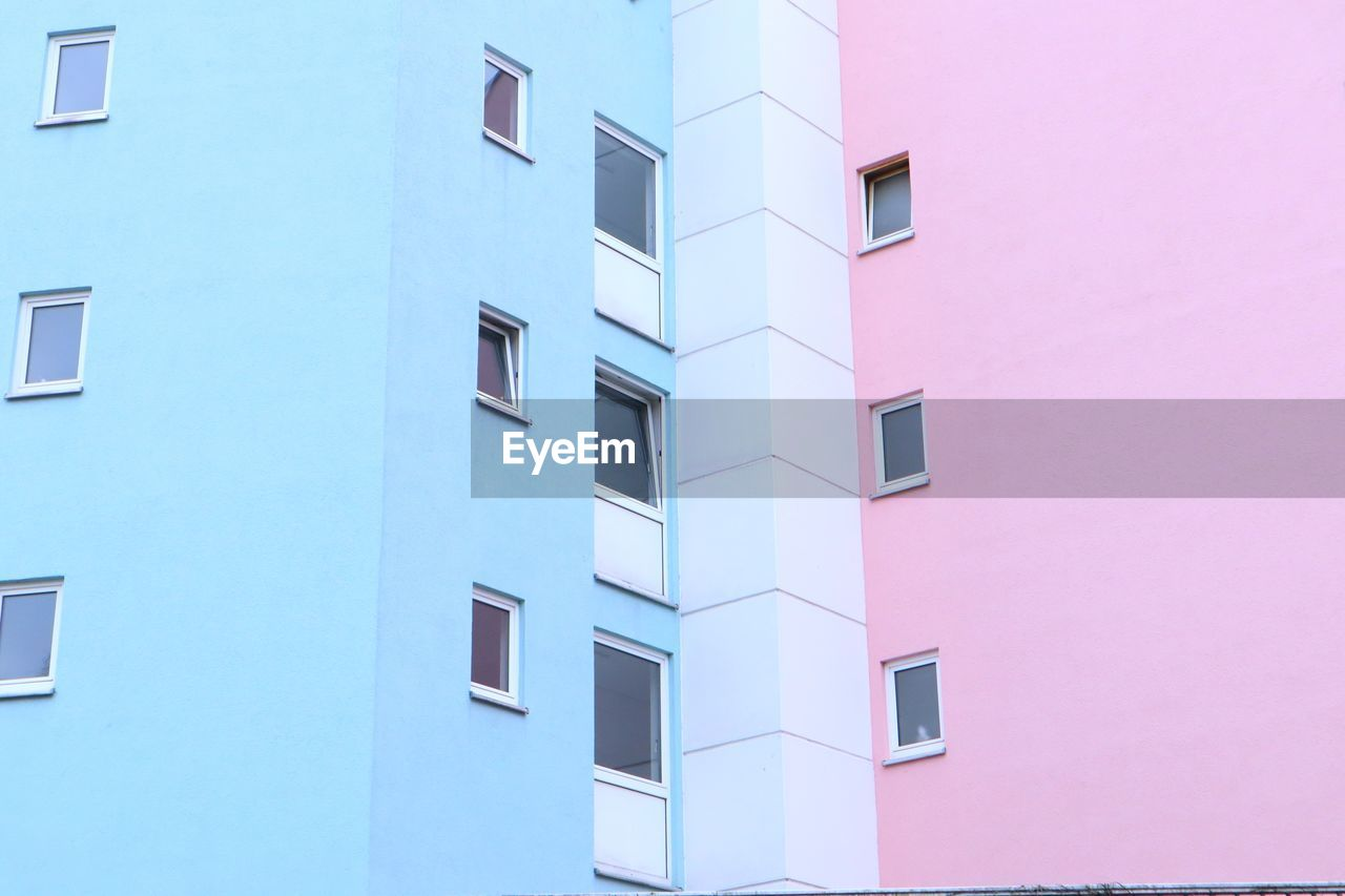 built structure, building exterior, architecture, window, building, low angle view, residential district, no people, day, full frame, apartment, outdoors, city, wall - building feature, nature, backgrounds, white color, pink color, sky, pattern