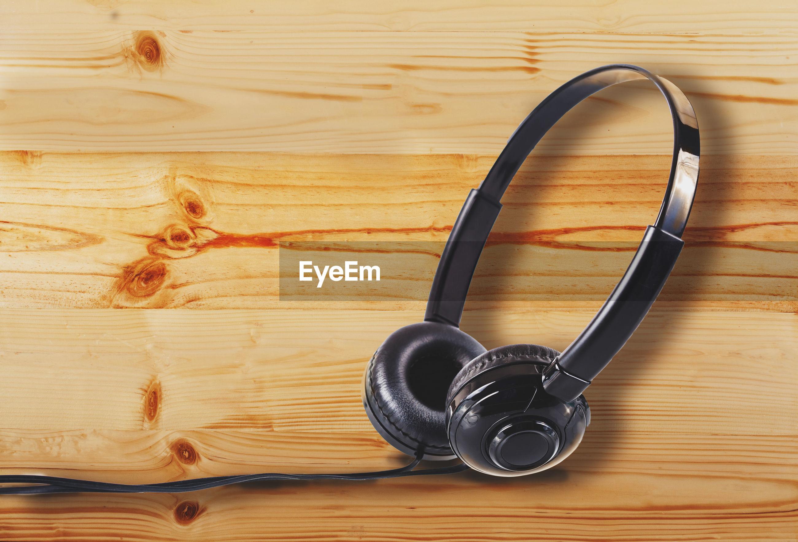 Headphones on wooden table