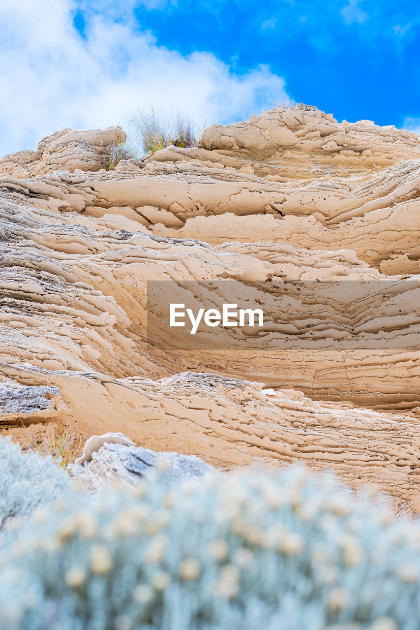 beauty in nature, scenics - nature, sky, non-urban scene, tranquility, tranquil scene, physical geography, day, cloud - sky, no people, nature, geology, rock, rock formation, solid, rock - object, land, remote, idyllic, landscape, outdoors, arid climate, hot spring, climate, eroded, power in nature