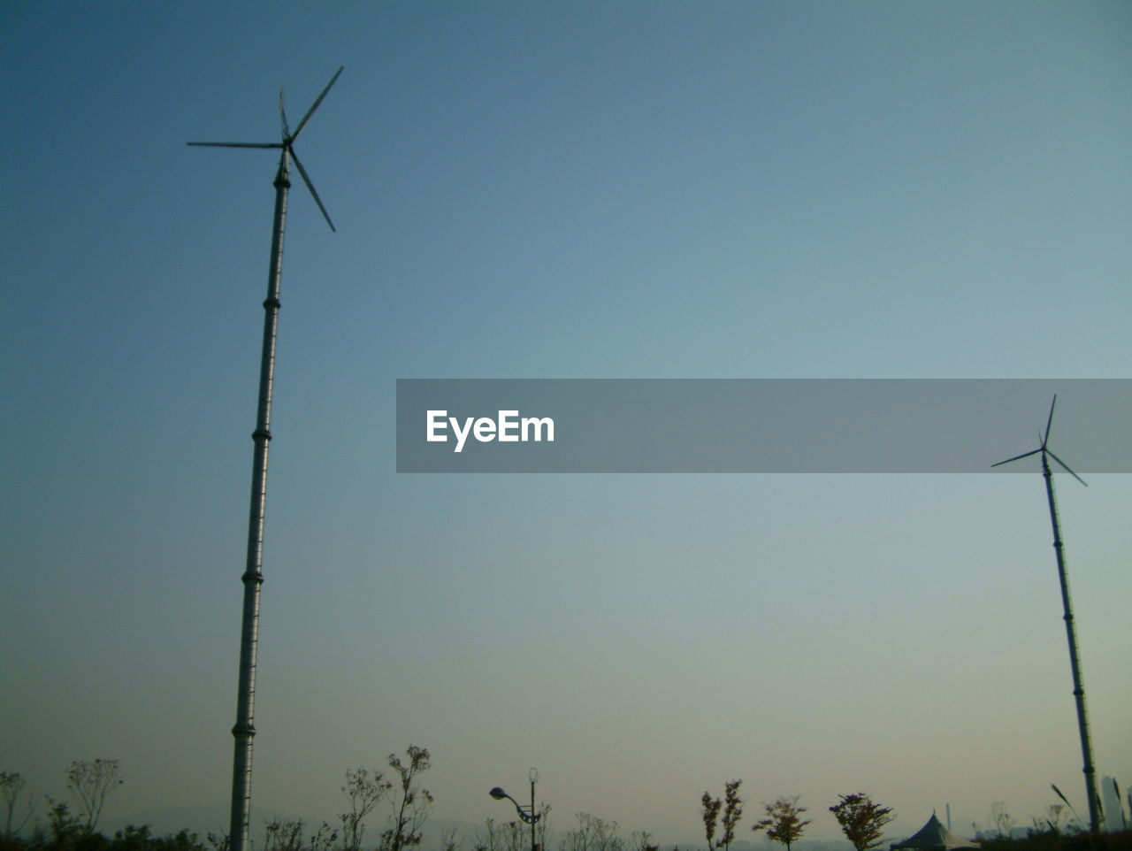alternative energy, wind turbine, wind power, environmental conservation, renewable energy, fuel and power generation, windmill, industrial windmill, technology, outdoors, low angle view, no people, rural scene, nature, day, traditional windmill, sky