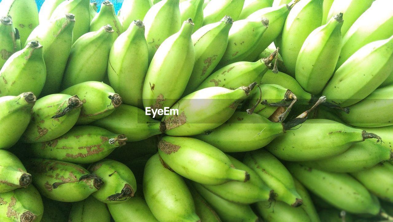 FULL FRAME SHOT OF GREEN FRUITS FOR SALE