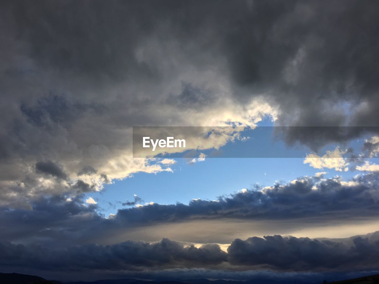 cloud - sky, beauty in nature, nature, sky, scenics, tranquility, tranquil scene, atmospheric mood, idyllic, cloudscape, no people, dramatic sky, weather, outdoors, sky only, low angle view, backgrounds, sunset, day, storm cloud