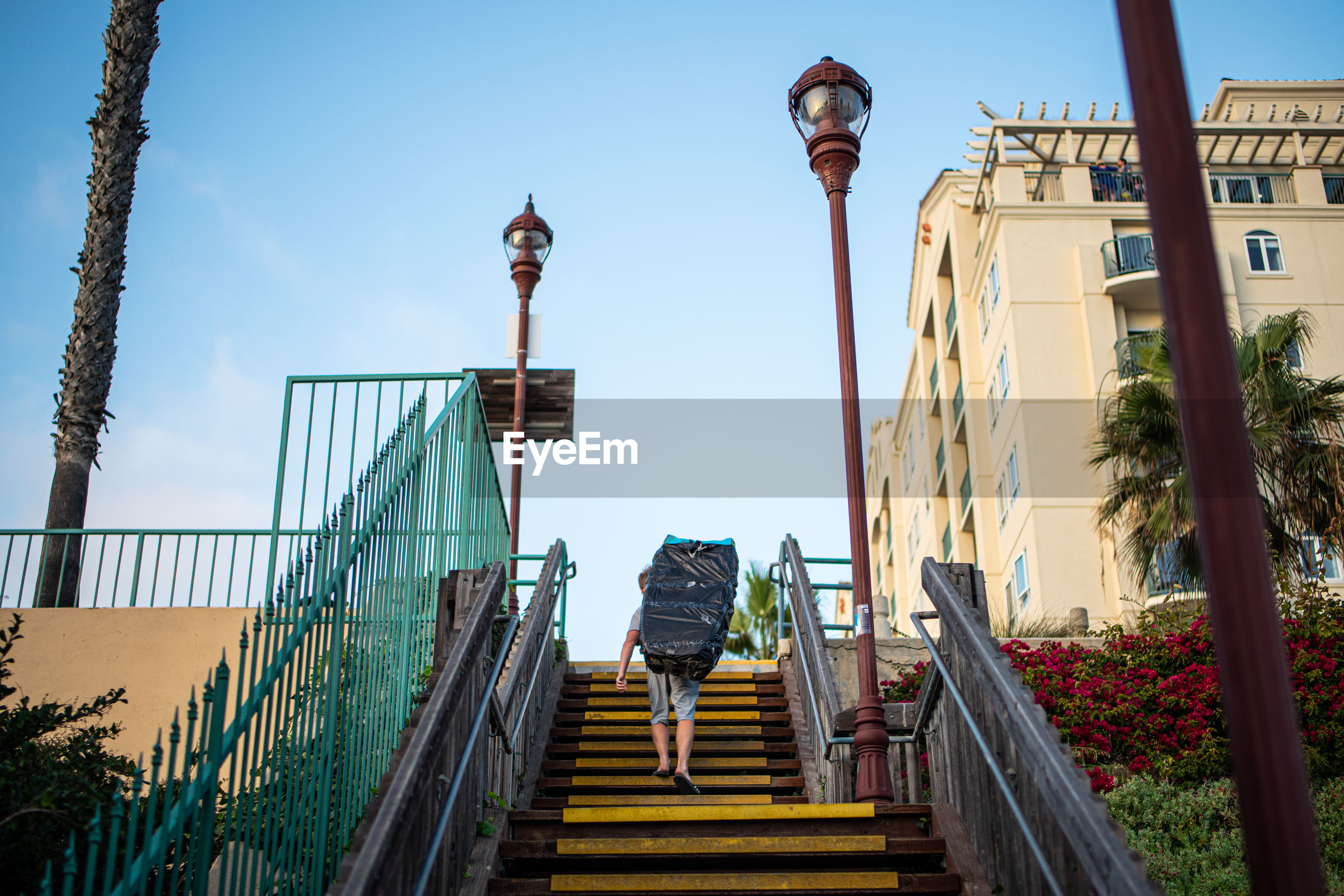 LOW ANGLE VIEW OF STEPS AND BUILDING AGAINST SKY