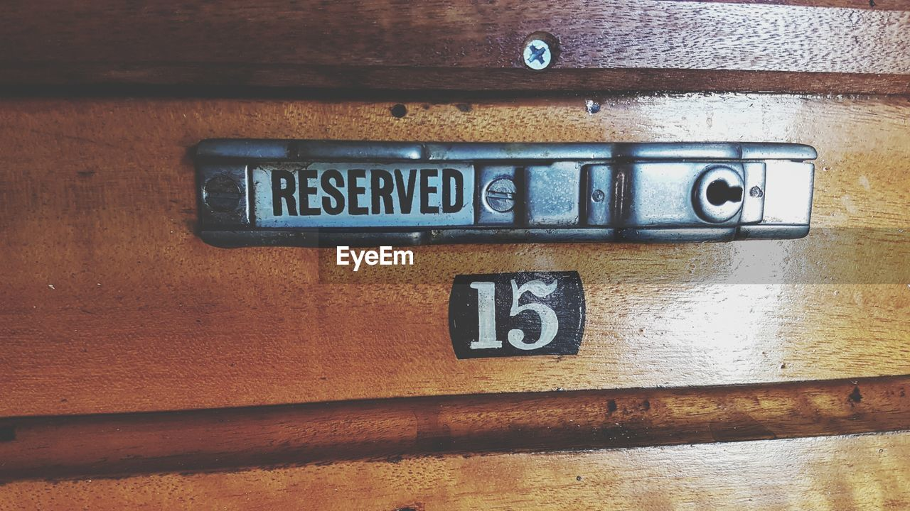 communication, number, close-up, text, no people, wood - material, western script, metal, indoors, capital letter, sign, full frame, day, old, brown, information, letter, entrance, technology, single word