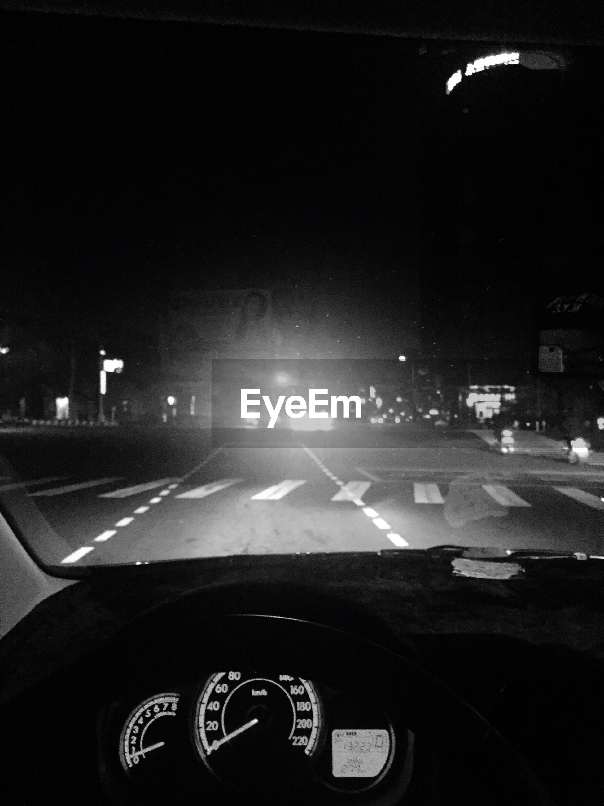 transportation, mode of transport, car, land vehicle, road, road marking, windshield, on the move, car interior, street, vehicle interior, travel, traffic, illuminated, night, glass - material, car point of view, motion, highway, city street