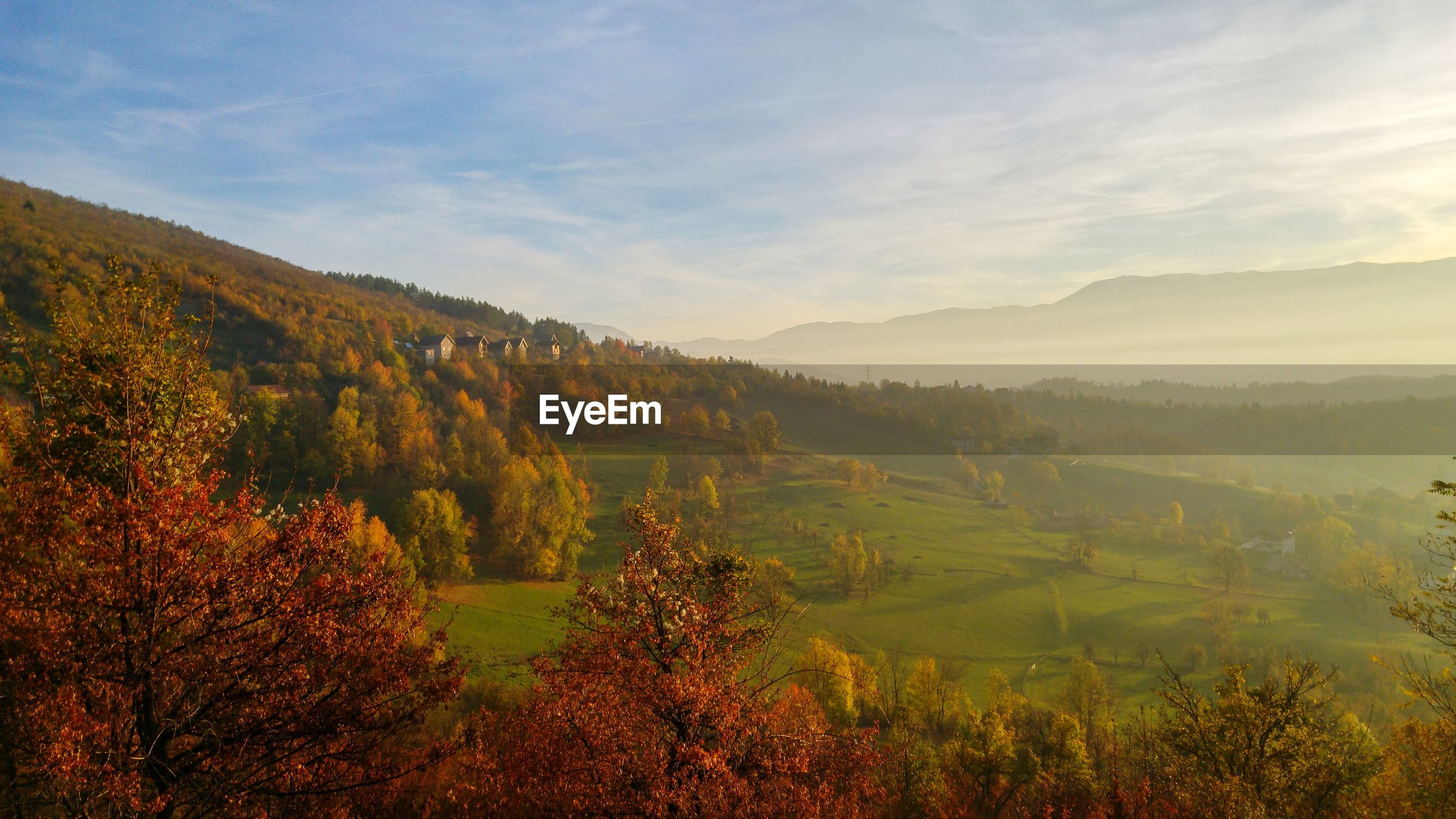 SCENIC VIEW OF LANDSCAPE DURING AUTUMN AGAINST SKY