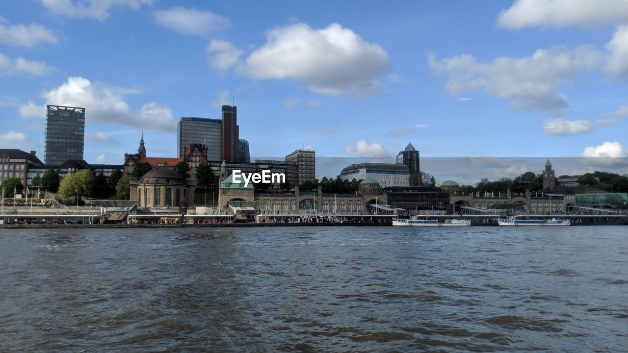 water, architecture, built structure, building exterior, sky, cloud - sky, waterfront, river, city, building, no people, nature, travel destinations, day, travel, transportation, outdoors, connection, office building exterior, cityscape, skyscraper