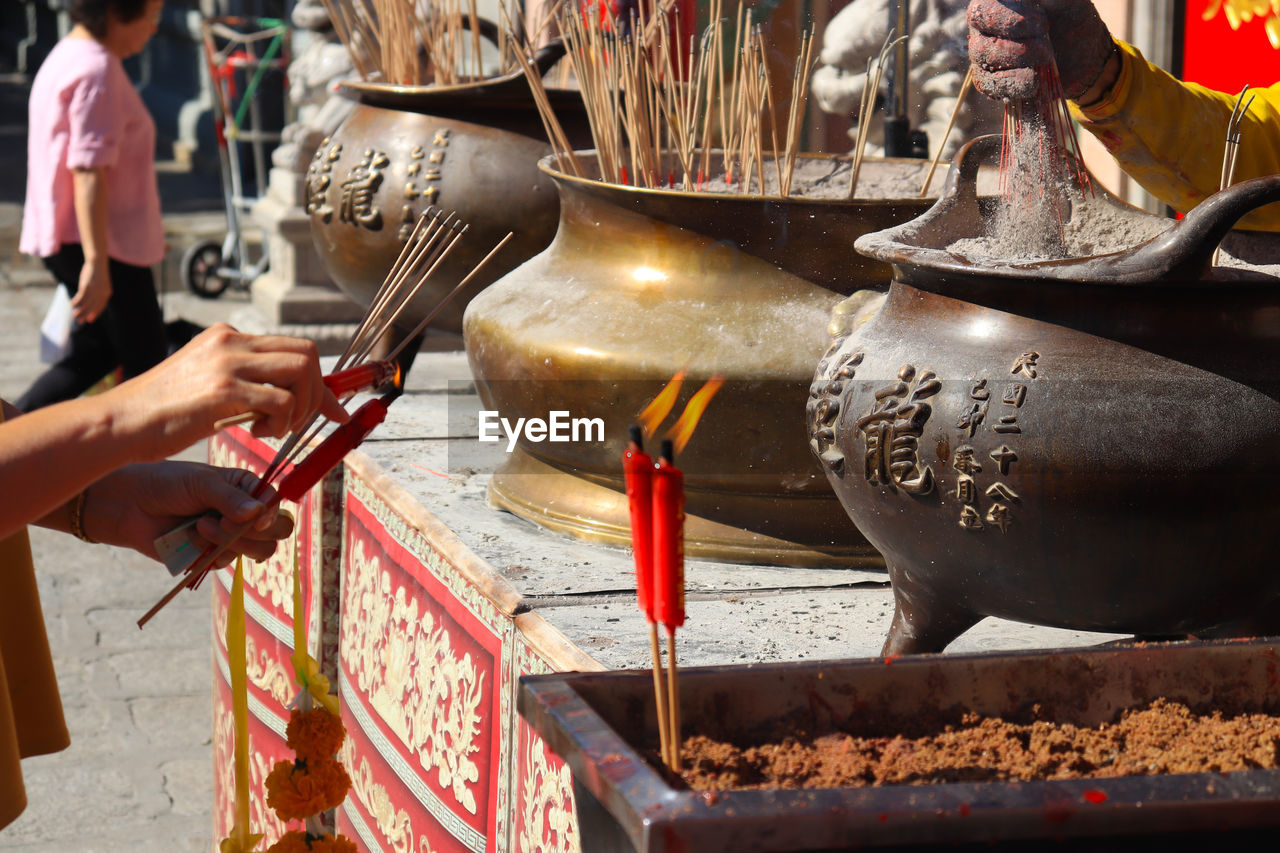 human hand, hand, spirituality, religion, incense, belief, human body part, one person, place of worship, real people, holding, burning, building, kitchen utensil, lifestyles, architecture, finger