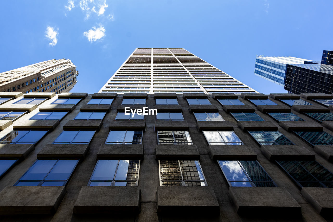 built structure, architecture, building exterior, low angle view, sky, building, city, office building exterior, office, no people, nature, modern, tall - high, day, window, cloud - sky, skyscraper, glass - material, blue, outdoors
