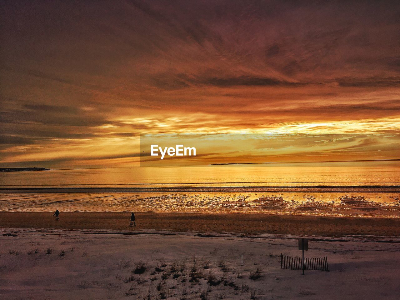 sunset, nature, beauty in nature, scenics, orange color, tranquil scene, sky, tranquility, cloud - sky, sea, water, silhouette, cold temperature, outdoors, horizon over water, beach, winter, snow, no people, day