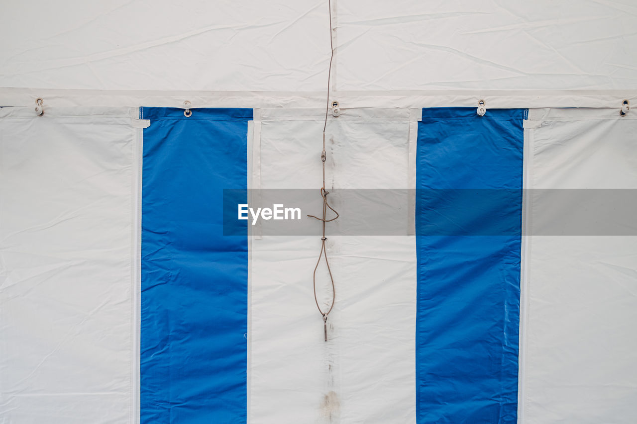 Part of blue and white striped tent