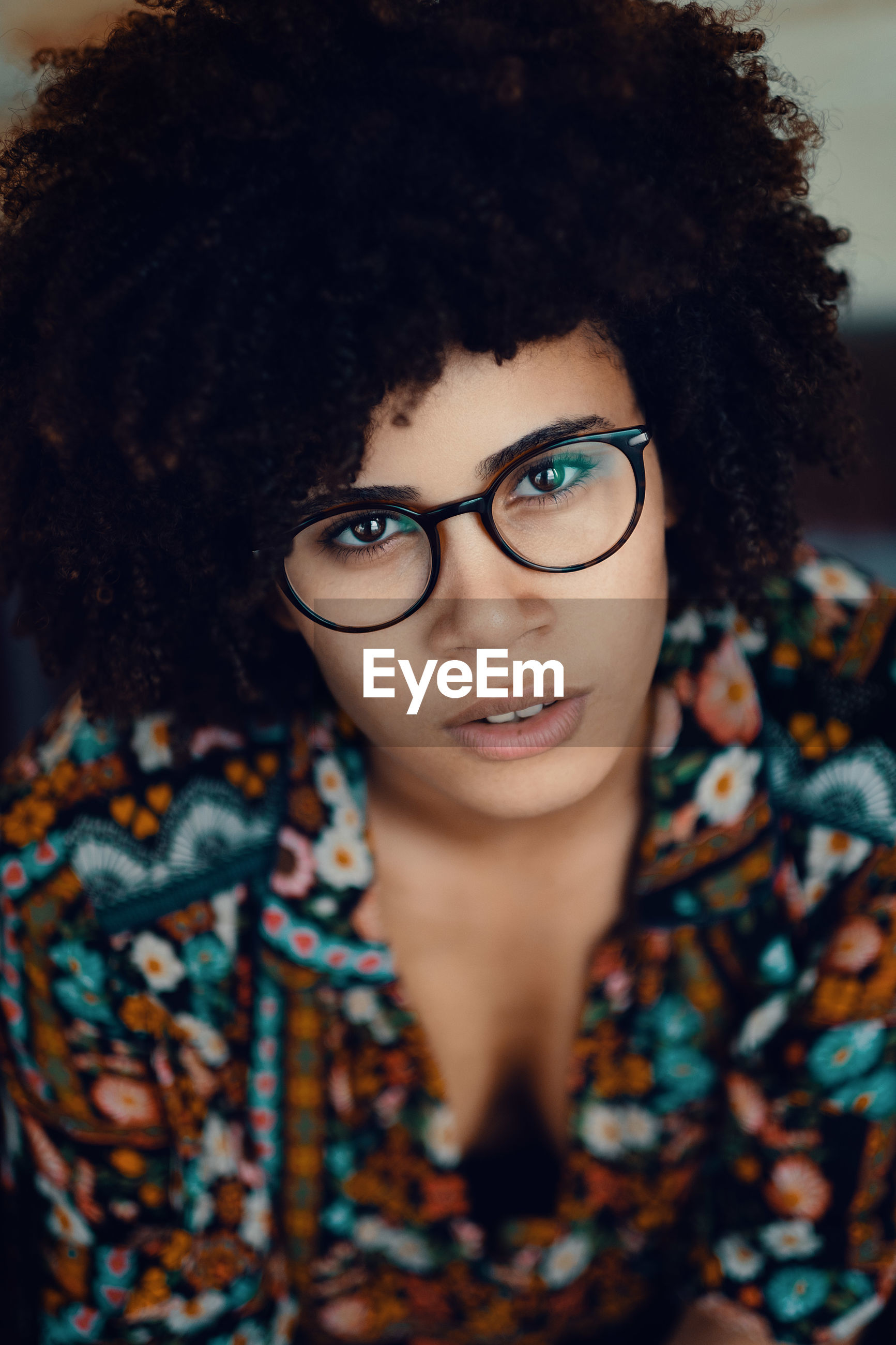 High angle portrait of afro teenage girl wearing eyeglasses
