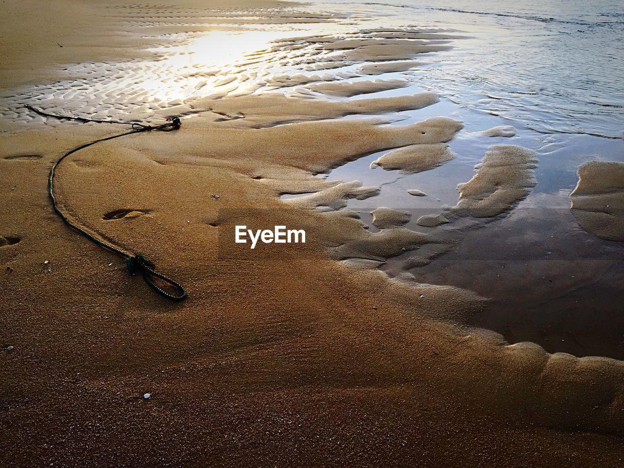 SAND AT BEACH AGAINST SKY