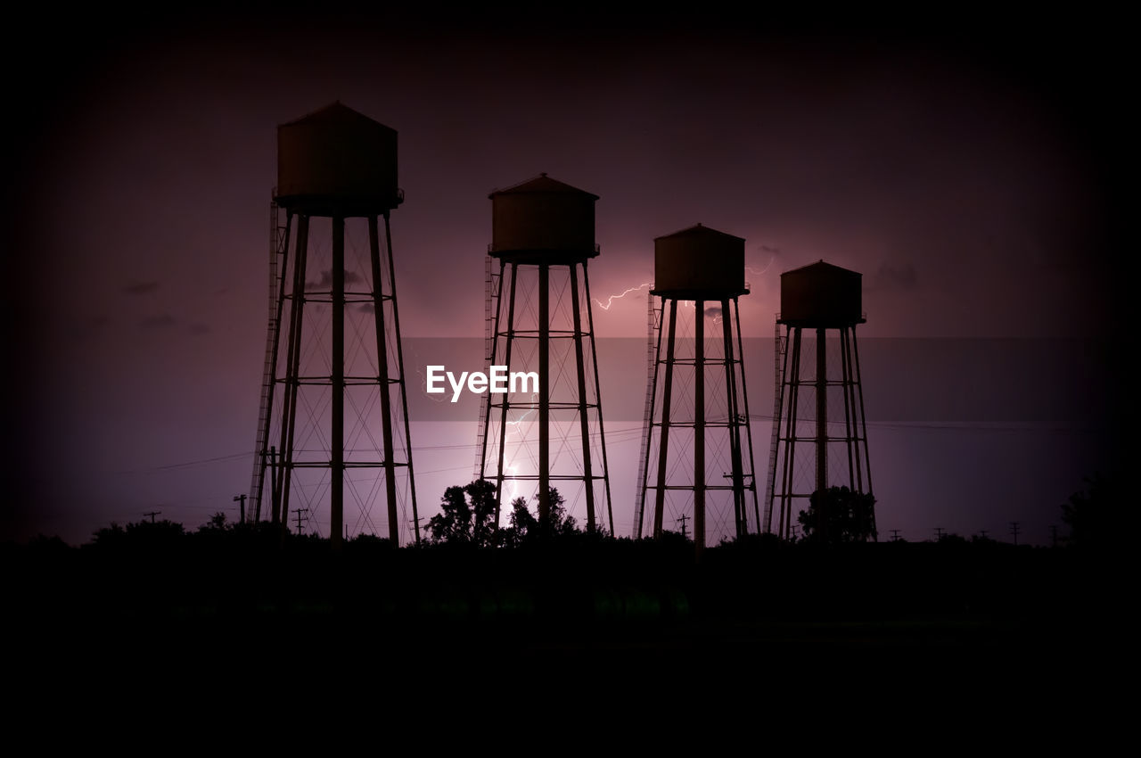 View of water tower against sky during sunset