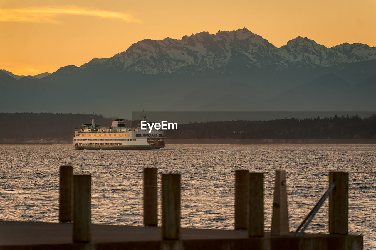 Ferry Boat In Puget Sound Against Mountain During Sunset