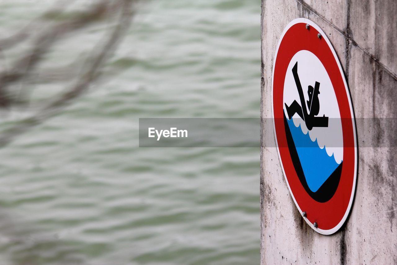 Slippery danger sign on wall