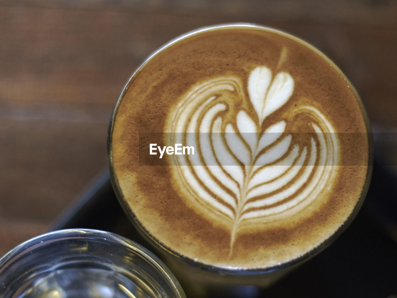 coffee - drink, food and drink, drink, refreshment, coffee cup, coffee, frothy drink, mug, hot drink, still life, cup, froth art, cappuccino, close-up, creativity, freshness, indoors, table, focus on foreground, latte, no people, crockery, non-alcoholic beverage, froth