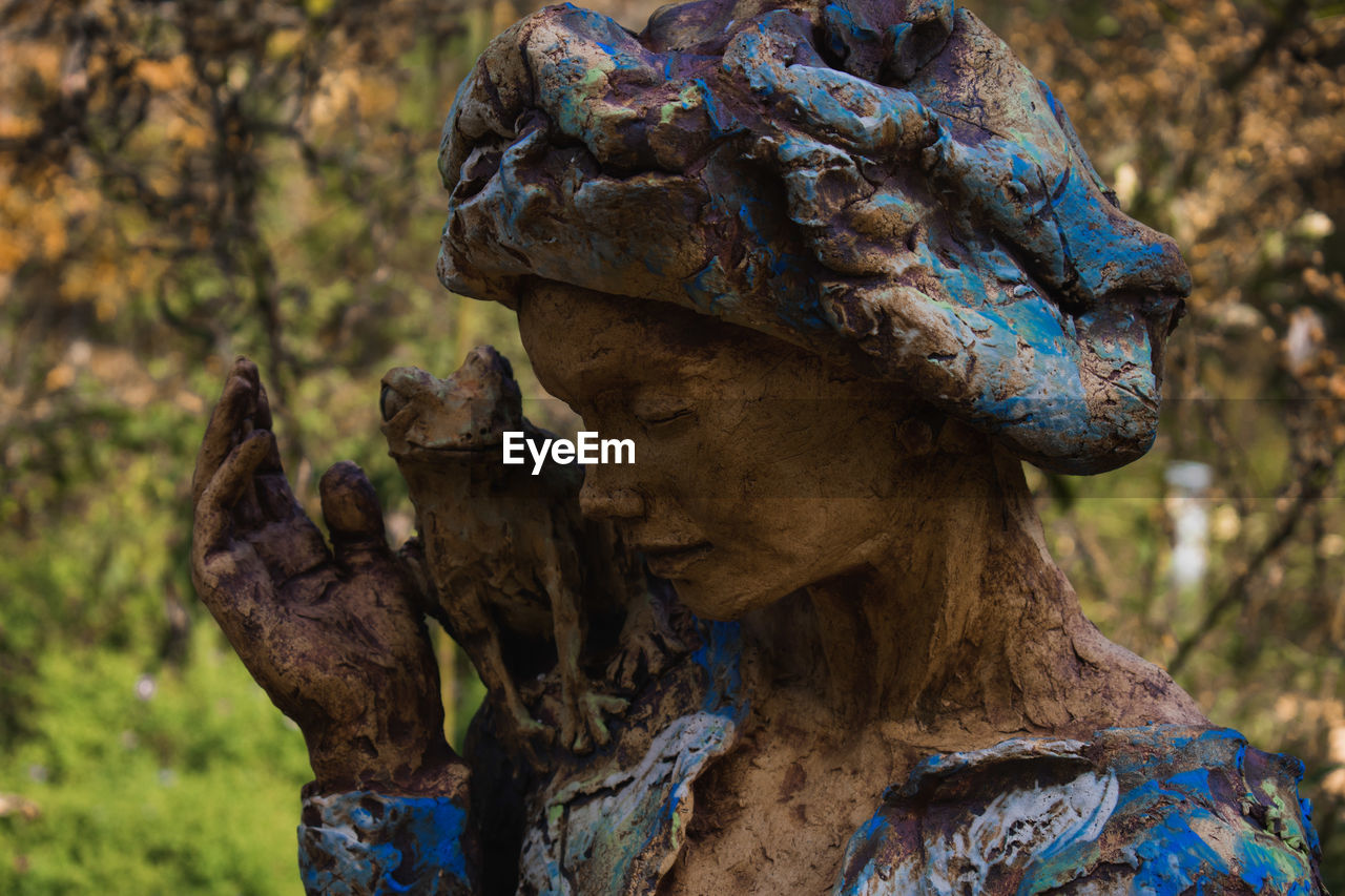 art and craft, representation, sculpture, statue, focus on foreground, human representation, day, creativity, no people, tree, nature, craft, close-up, plant, outdoors, old, male likeness, land, female likeness, forest