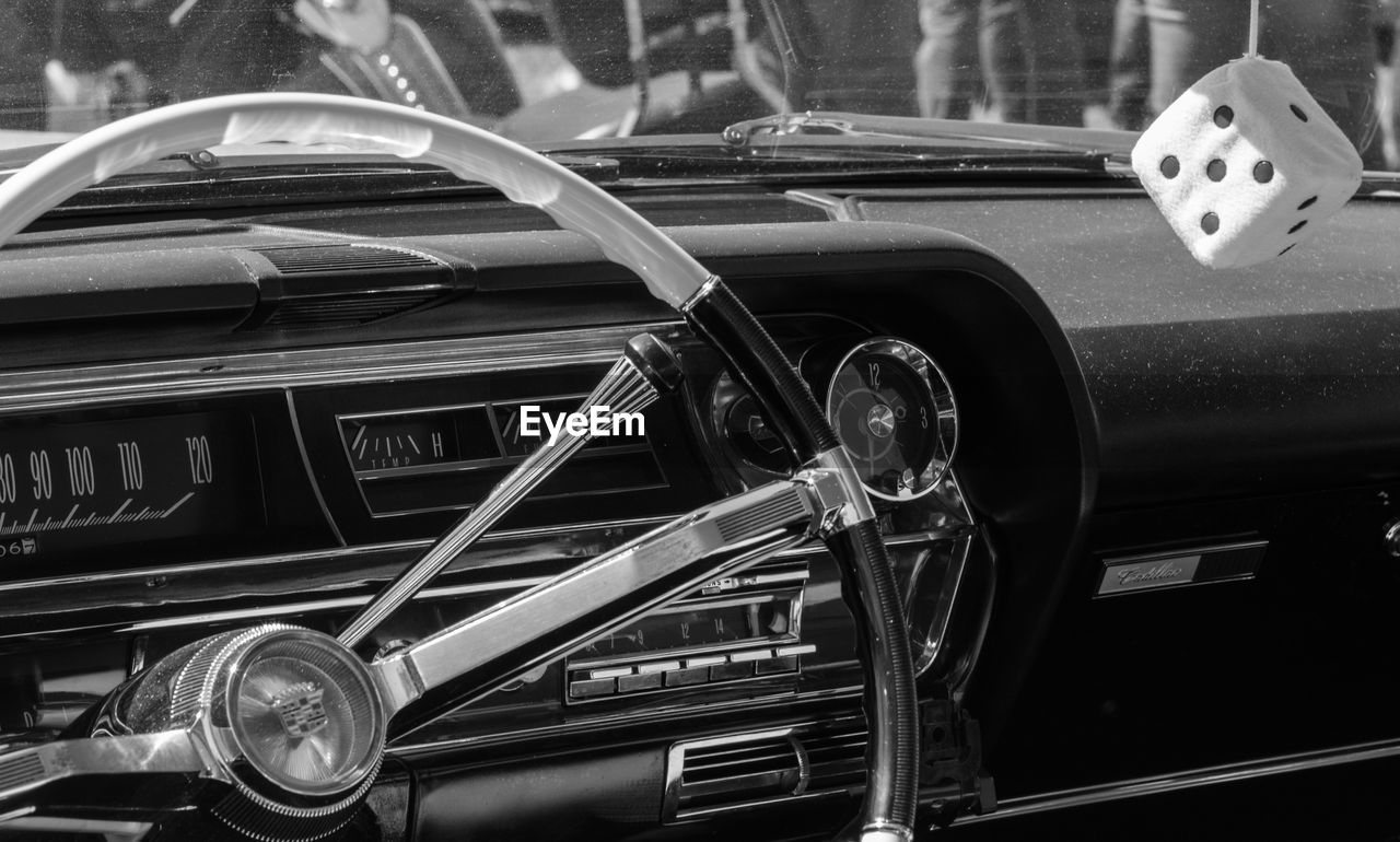 car, land vehicle, transportation, mode of transport, vintage car, headlight, old-fashioned, retro styled, steering wheel, car interior, dashboard, day, collector's car, outdoors, no people, close-up, luxury, vehicle part