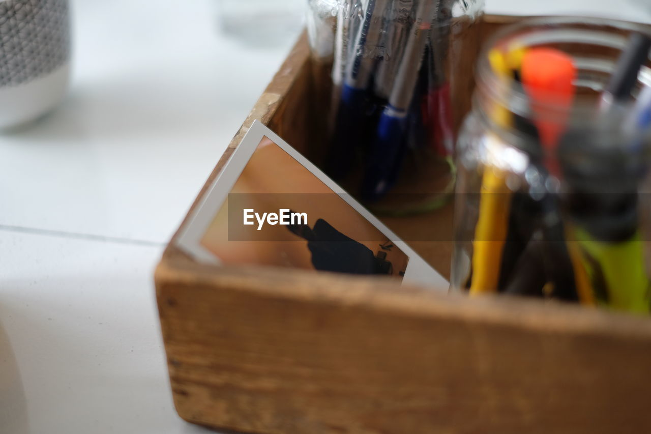 selective focus, wood - material, indoors, no people, close-up, musical instrument, day