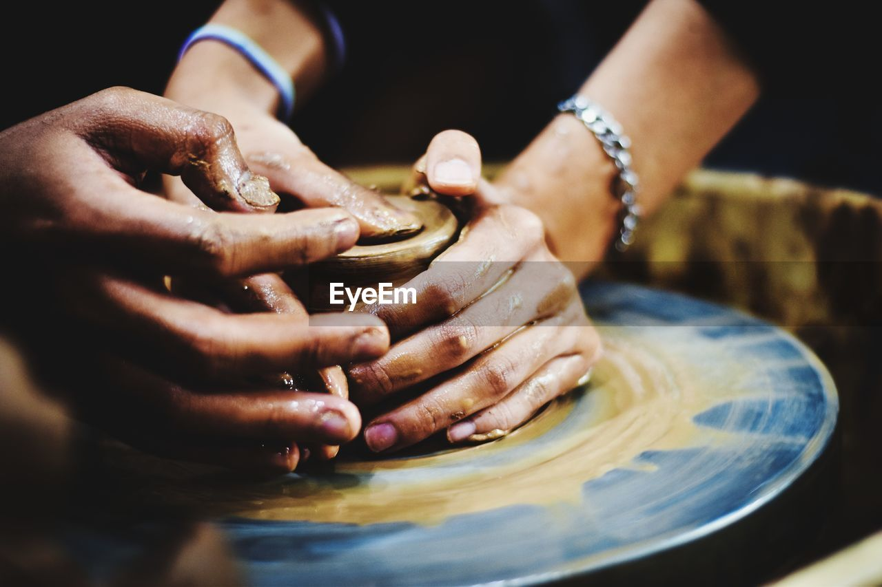 one person, hand, human hand, focus on foreground, real people, indoors, human body part, close-up, spinning, skill, human finger, lifestyles, finger, body part, holding, selective focus, food and drink, occupation, creativity