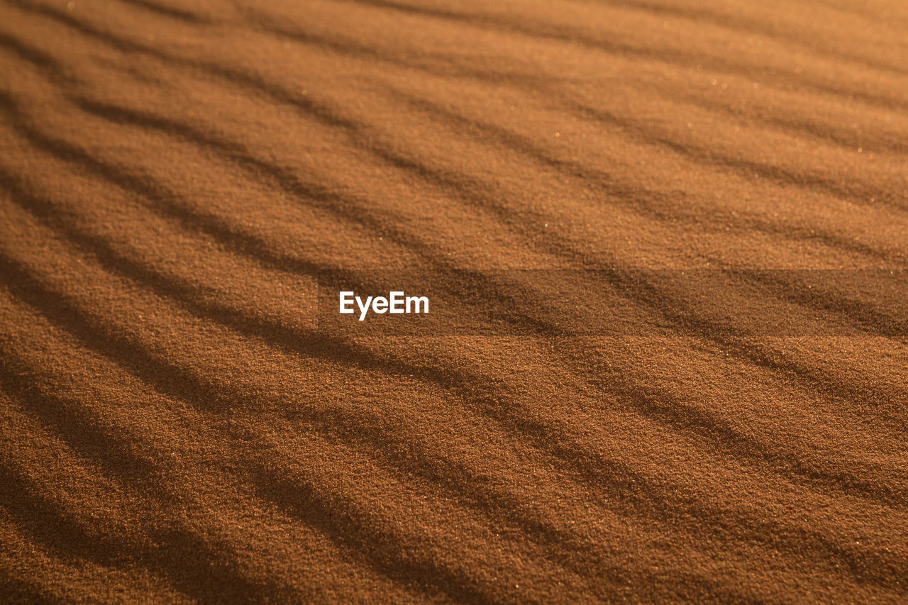 land, full frame, backgrounds, pattern, landscape, no people, tranquility, high angle view, agriculture, rural scene, environment, nature, sand, scenics - nature, brown, tranquil scene, wave pattern, beauty in nature, farm, day, climate, arid climate