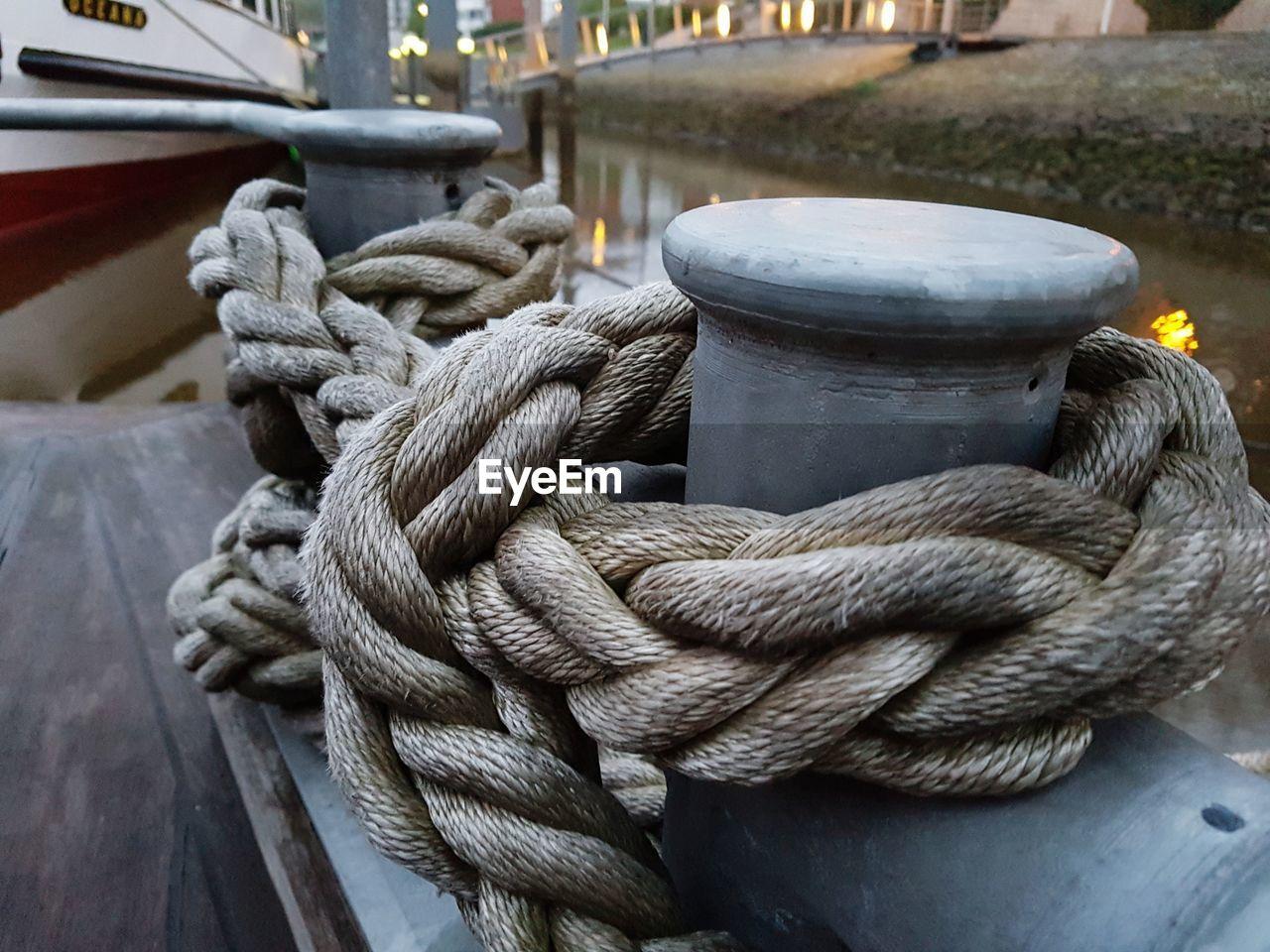 Close-Up Of Rope Tied Up At Harbor