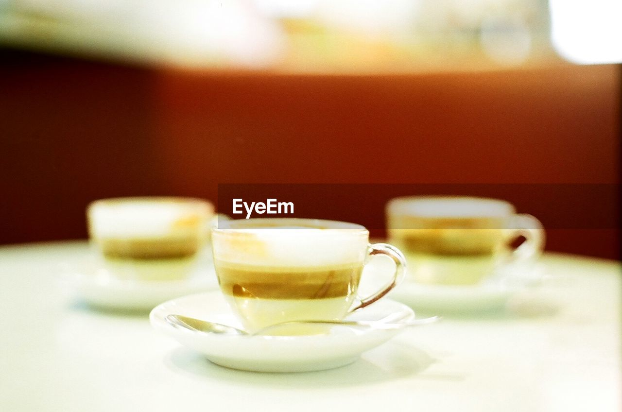coffee cup, coffee - drink, drink, food and drink, refreshment, cup, saucer, table, no people, freshness, indoors, close-up, frothy drink, focus on foreground, cappuccino, day