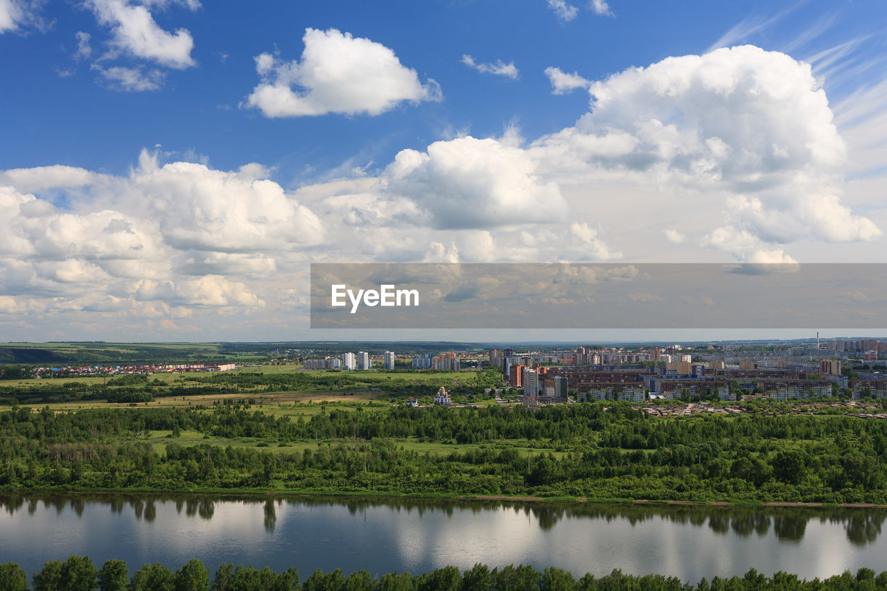 Scenic View Of Lake And Buildings Against Sky