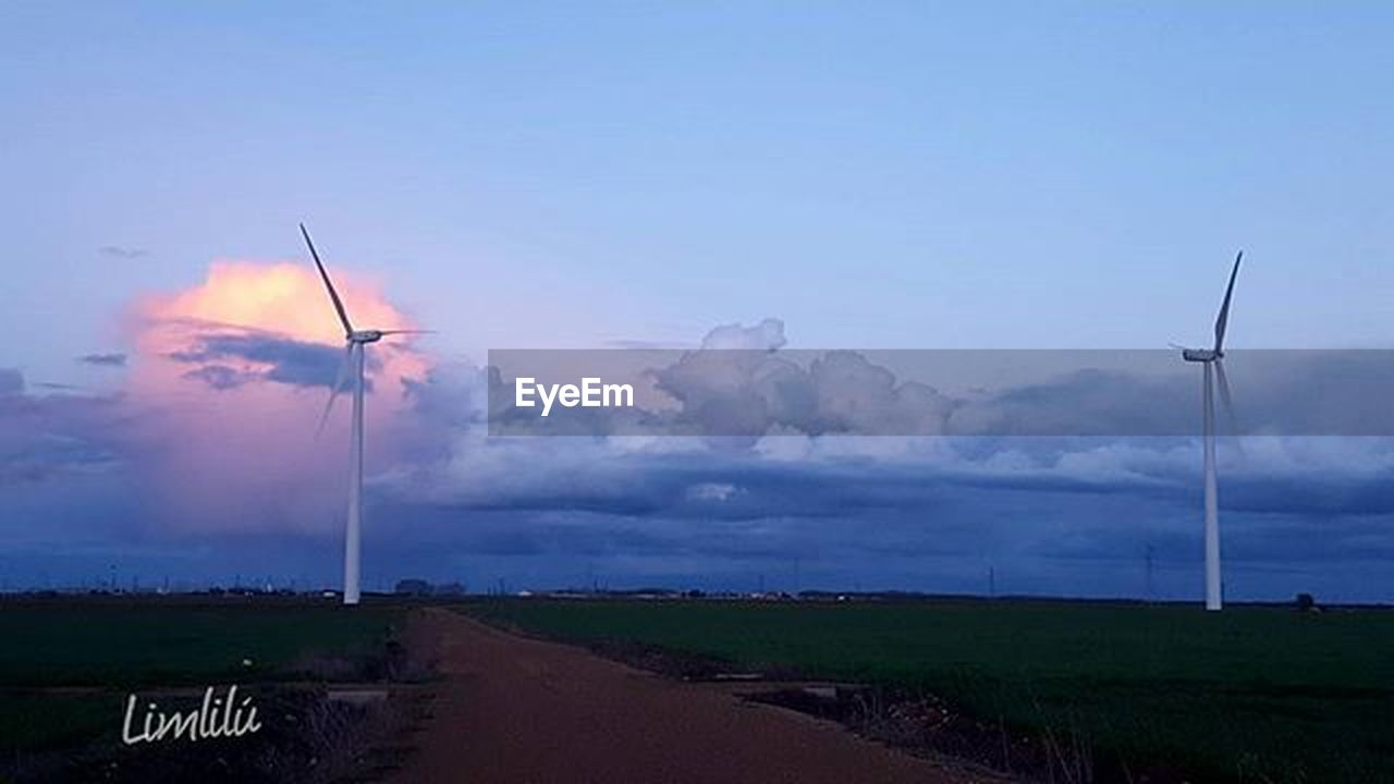 environmental conservation, wind turbine, wind power, alternative energy, fuel and power generation, renewable energy, cloud - sky, landscape, social issues, field, nature, power in nature, sky, outdoors, rural scene, sunset, beauty in nature, technology, no people, mountain, day, photography themes, grass, windmill