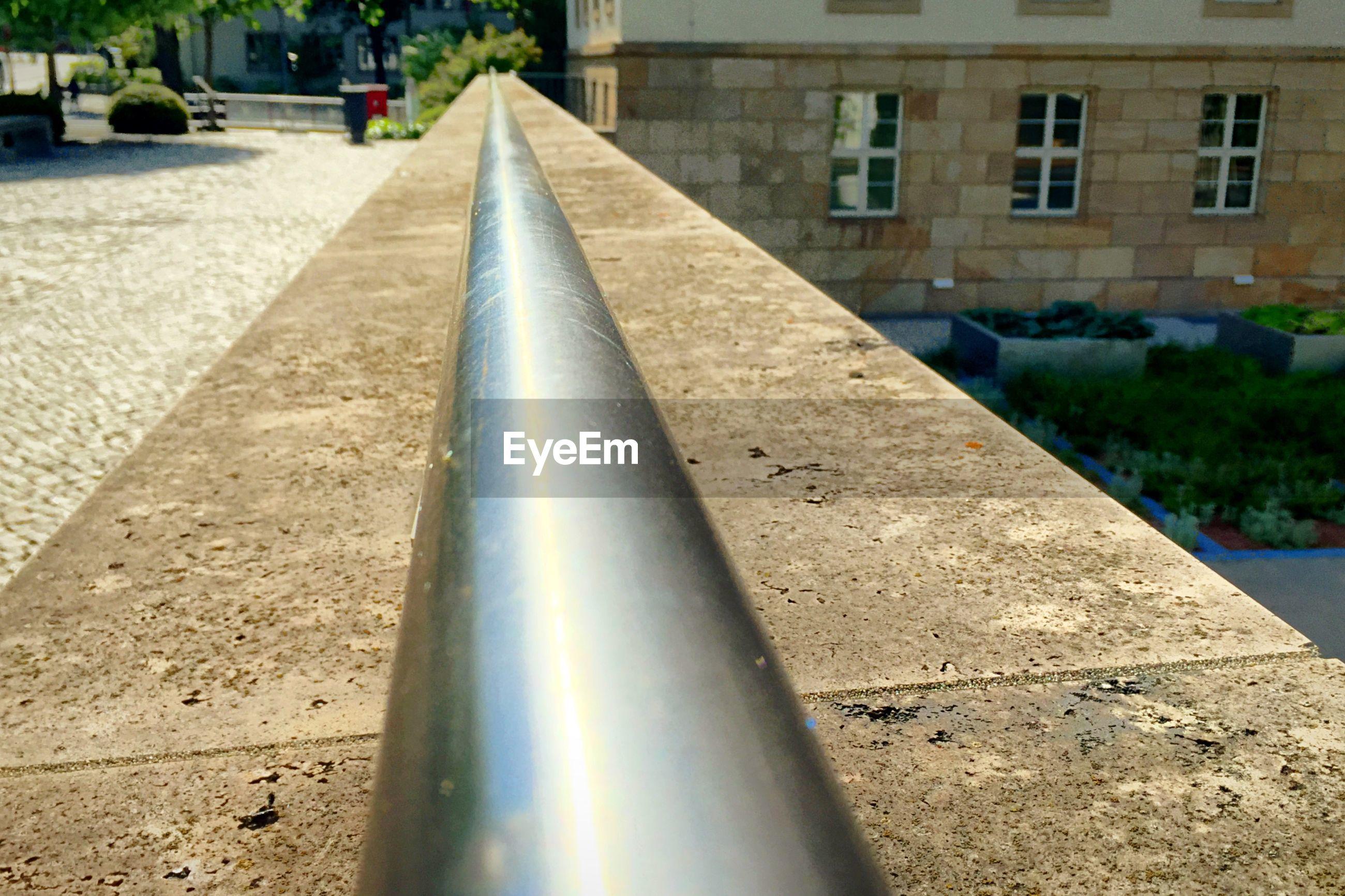 Detail shot of railing against built structure