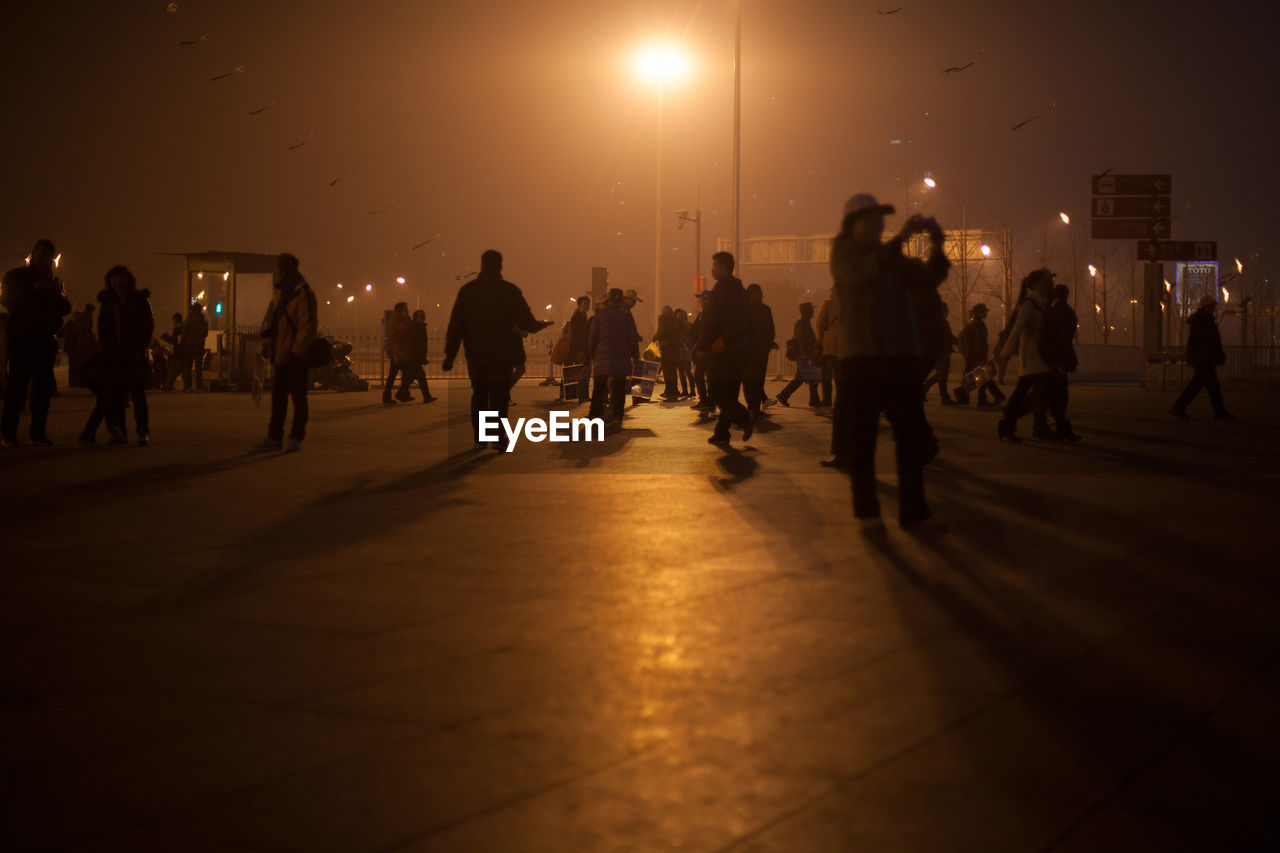 People At Illuminated Entrance Of Beijing Olympic Park At Night