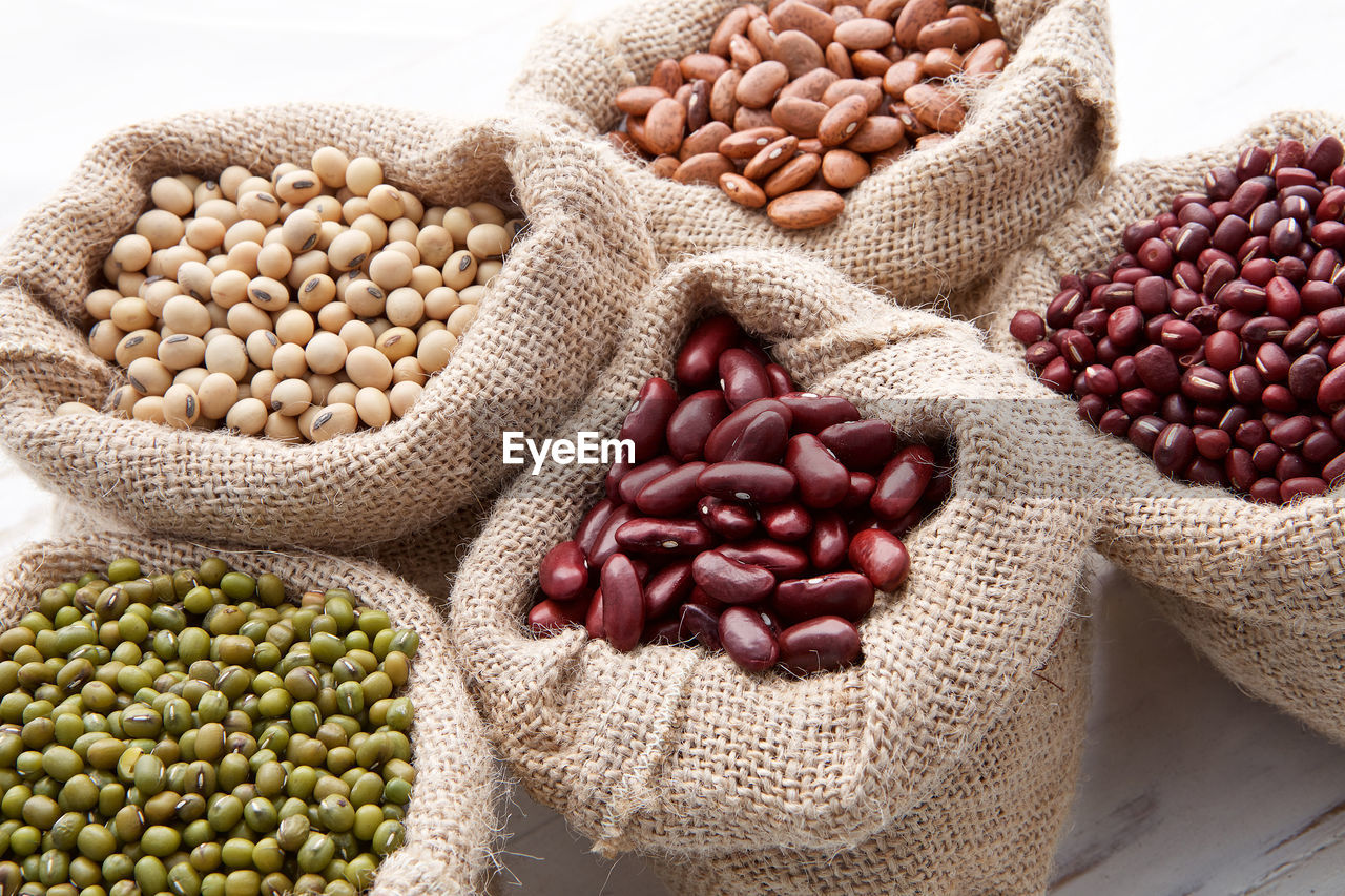 food, food and drink, sack, freshness, bean, wellbeing, healthy eating, large group of objects, vegetable, raw food, no people, indoors, heap, still life, close-up, burlap, abundance, bag, seed, plant, legume family, vegetarian food, jute